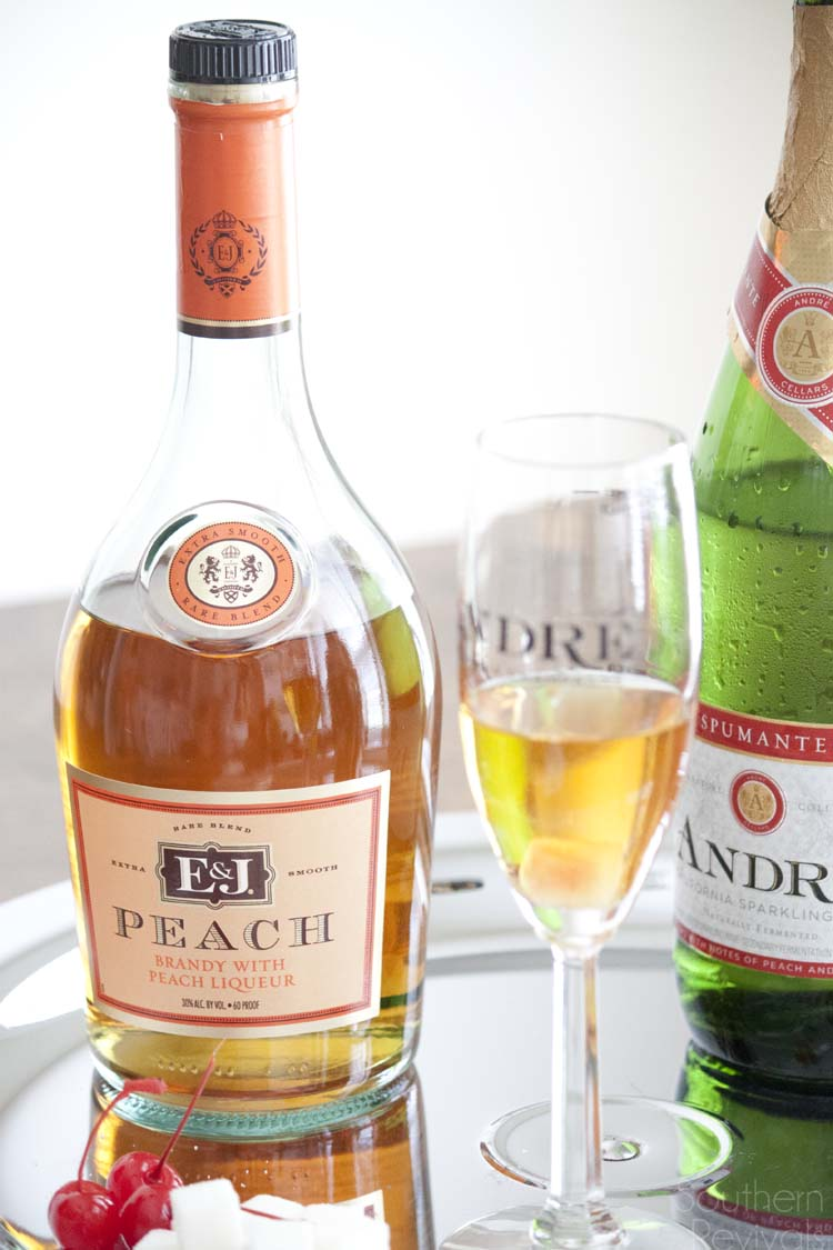 Champagne isn't just for New Year's! Celebrate anytime with these easy champagne cocktails. Peach Brandy & Cotton Candy Champagne Cocktails #EpicWithAndre #ad