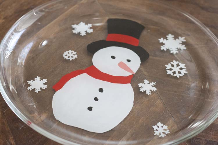 Super easy and oh so cute! If you have at least one hand and some paint brushes you can DIY your own Snowman Christmas Cookie Platter, too. Here's how!