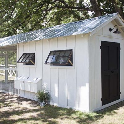 white and black farmhouse chicken coop