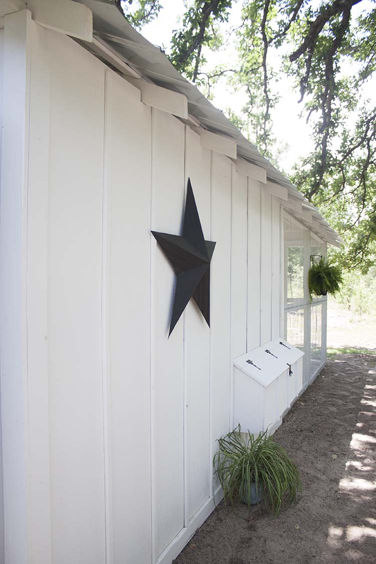 white building black barn star
