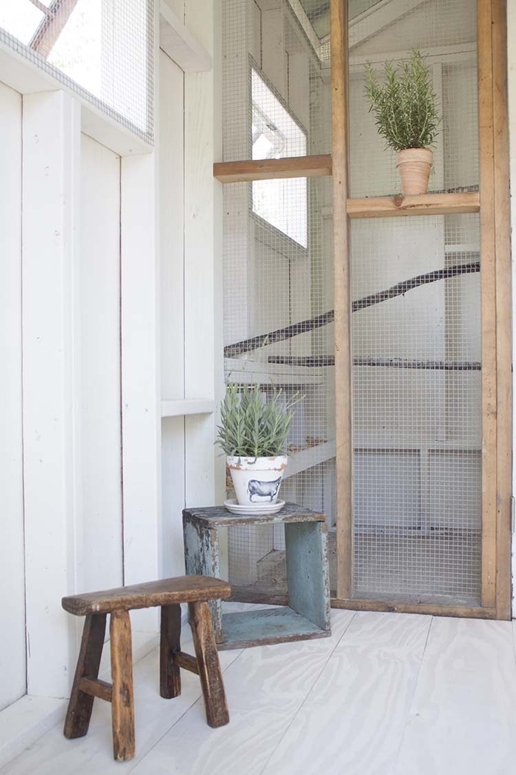 wooden stool inside chicken coop