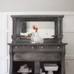 grey antique buffet white dishes