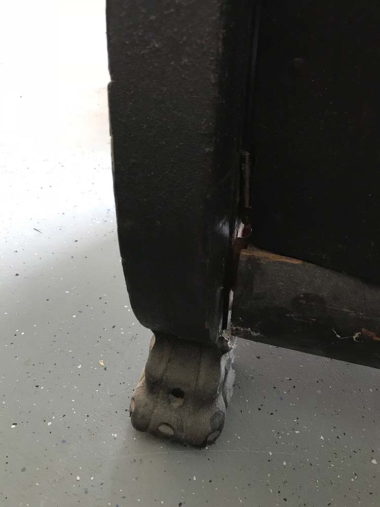 black broken antique buffet leg