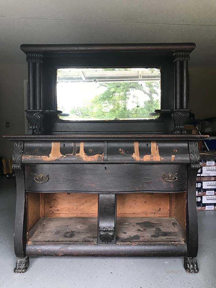 antique black buffet before