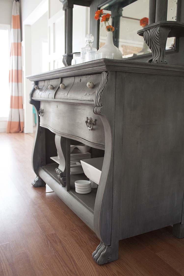 grey antique buffet white dishes orange stripe curtain