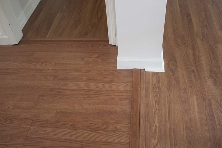 multiple thresholds laminate flooring