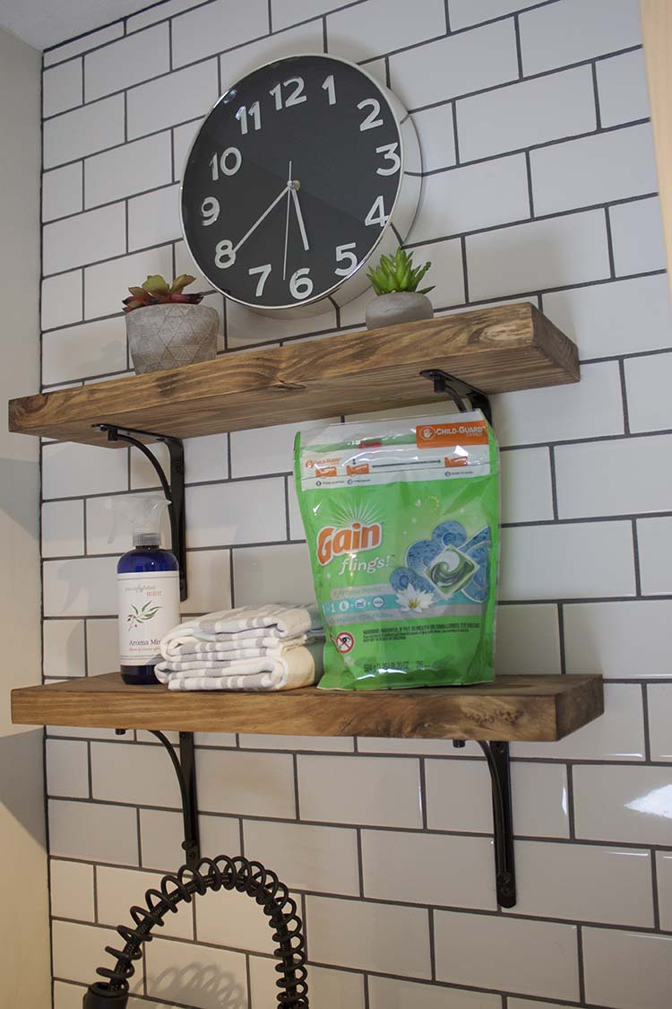 subway tile wall wood shelves