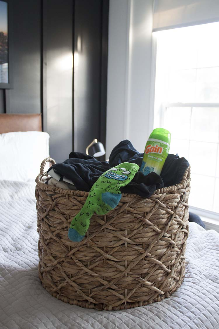 laundry basket on bed