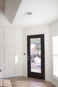 white board and batten black door