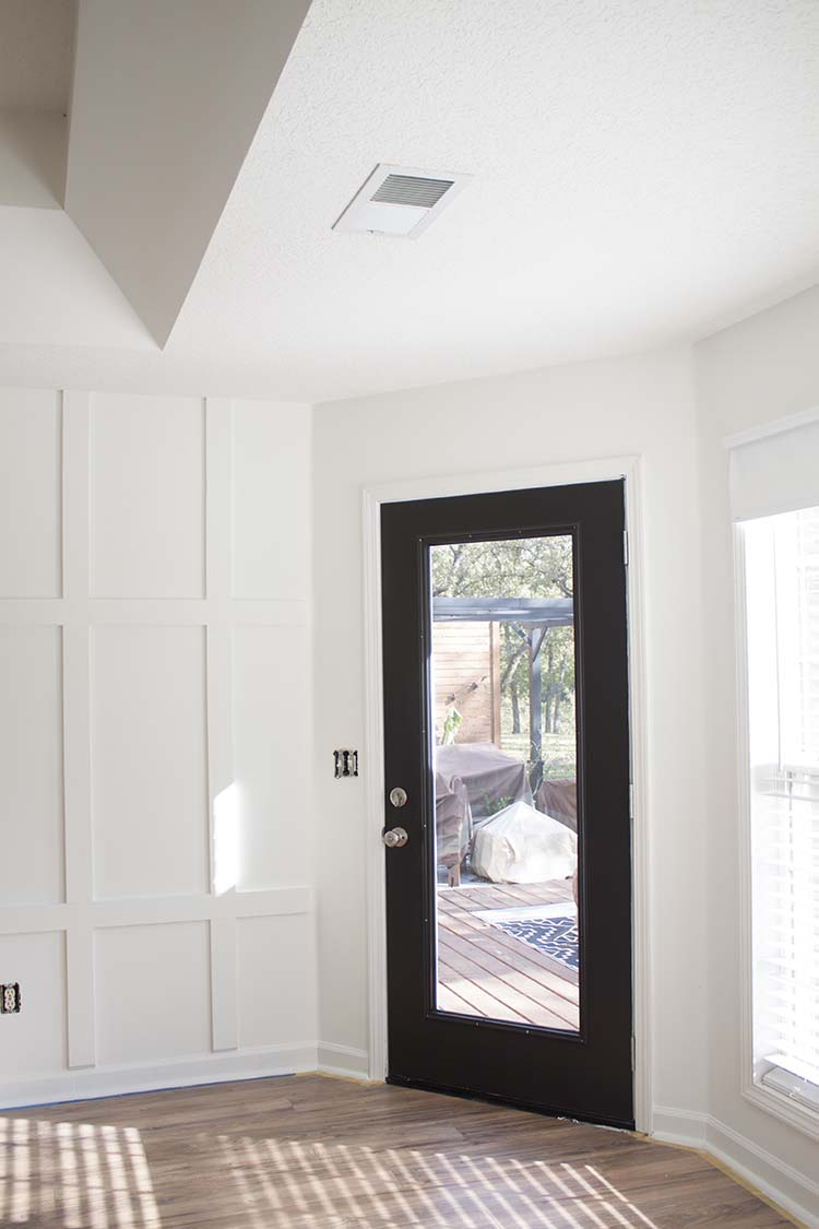 white board and batten black door