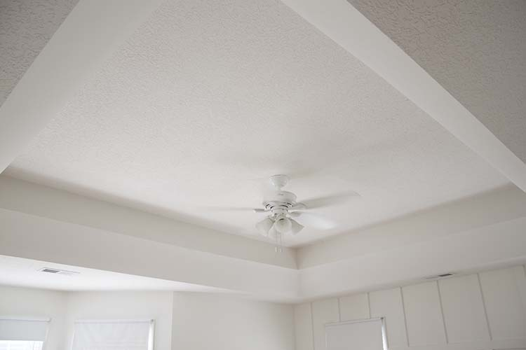 White trayed ceiling white bedroom