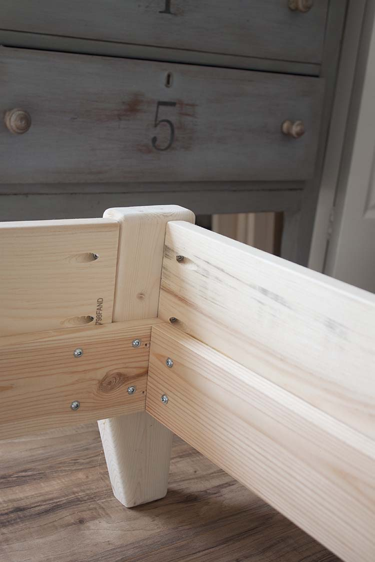 closeup wood bed frame legs