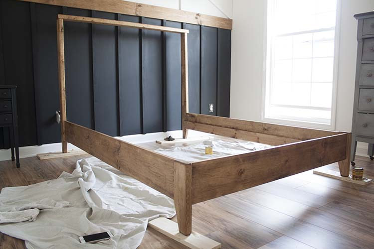 stained wood bed frame